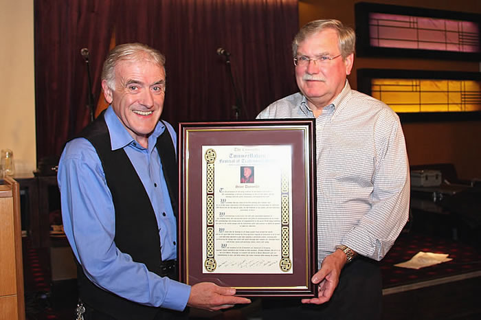Seán Donnelly was given the prestigious '' Keeper of The Tradition'' award at the Tommy Makem  Festival of Song on the 8th of October at the City Hotel Armagh. Making the presentation to Seán is Larry Scanlon of Boston Mass